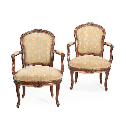 A pair of late Louis XV walnut fauteuils