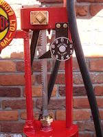 A Gilbert & Barker square rack petrol pump in Russian Oil Products livery,