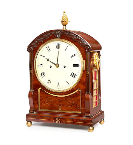 A Regency mahogany and brass inlaid bracket clock