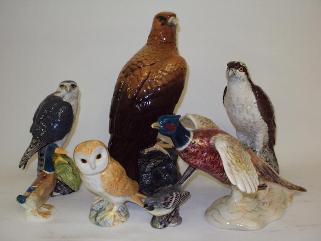 A group of Beswick bird figures and flasks