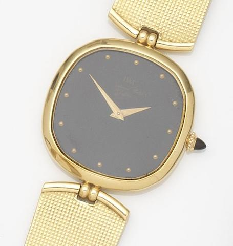IWC. An 18ct gold manual wind bracelet watchRef:2083, Case No.2272663, Movement No.2355484, Circa 1978