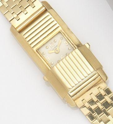 Cartier. A lady's 18ct gold manual wind back winding shutter bracelet watchCase No.90568, Movement No.246881, Circa 1930