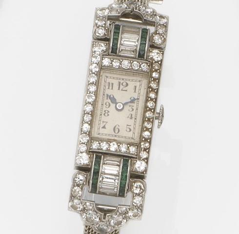 Patek Philippe. A lady's platinum, diamond and emerald set manual wind cocktail watch Case No.10155, Movement No.817173, Circa 1923