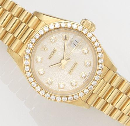 Rolex. A lady's 18ct gold automatic calendar bracelet watch with box and papers Ref:69138, Case No.W677***, Movement No.3292***, Sold 6th September 1996