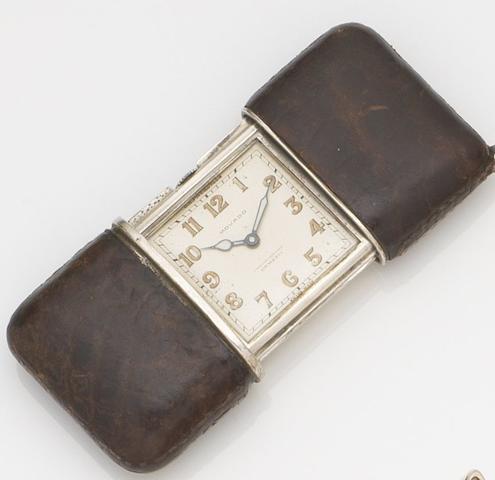 Movado. A lady's silver manual wind sliding purse watch Case No.1217077, Circa 1930