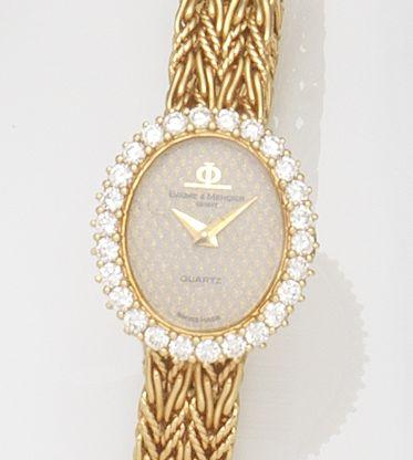 Baume & Mercier. A lady's 18ct gold and diamond set quartz bracelet watch with box and papers Ref:18516, Case No.1357204, Circa 1980