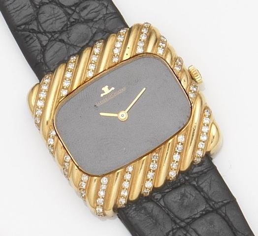 Jaeger-LeCoultre. An 18ct gold and diamond set manual wind wristwatch Ref:9135, Case No.1427097, Movement No.2225748, Circa 1970
