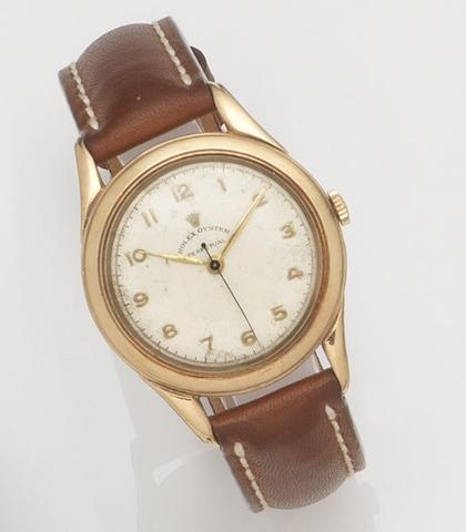 Rolex. A 9ct gold automatic centre seconds wristwatch Oyster Perpetual, Movement No.03580, Birmingham Hallmark for 1954