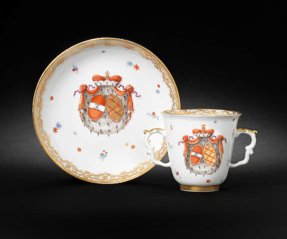 A Meissen double-handled armorial beaker and saucer from the Althann/Daun service circa 1735