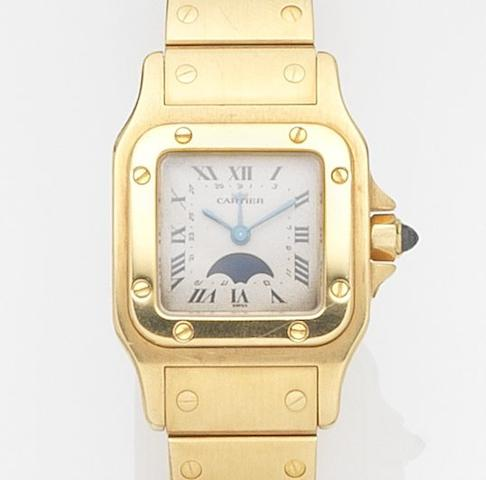 Cartier. An 18ct gold quartz calendar bracelet watch with moon phase Santos, Ref:0036, Case No.19902, Circa 1990