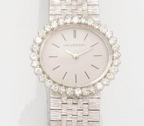 Universal. A lady's 18ct gold and diamond set manual wind bracelet watch London Hallmark for 1968