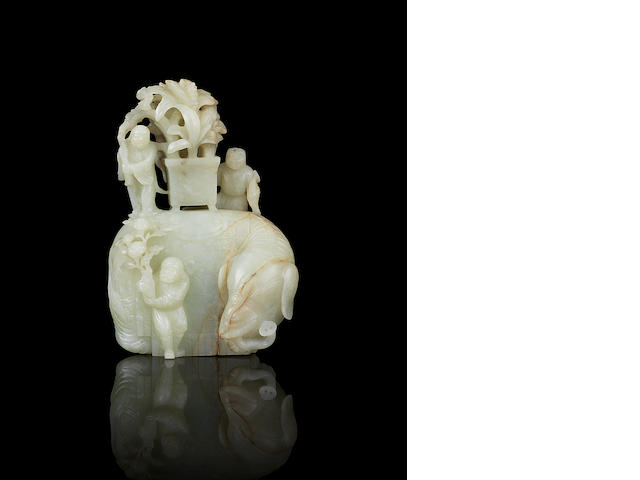 A rare and fine pale green jade carving of an elephant and grooms 17th/18th century
