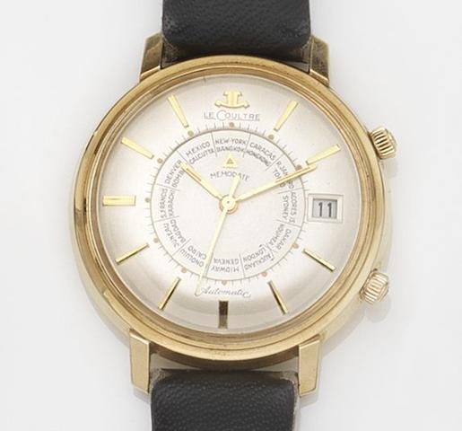 LeCoultre. A 14ct gold automatic calendar alarm wristwatch Memodate, Circa 1960