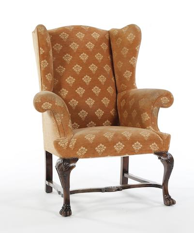 An upholstered wing back chair