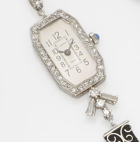 Norman. A lady's platinum and diamond set lapel watchCirca 1910