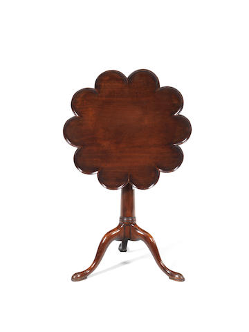 A George III mahogany tripod table with a scalloped top