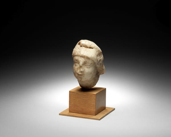 A Roman marble relief fragment of a female head