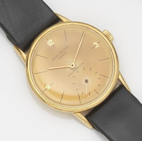 Patek Philippe. An 18ct gold manual wind wristwatch Calatrava, Ref:2494, Case No.515337, Movement No.725801, Retailed by Hausmann & Co, Circa 1940