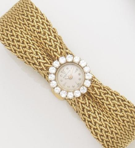 Cartier. A lady's 18ct gold and diamond set manual wind bracelet watchRef:8514, Case No.701980, Movement No.1172788, Circa 1950