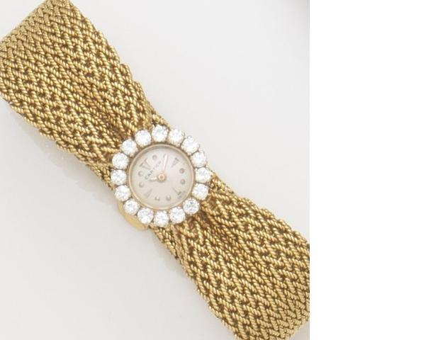 Cartier. A lady's 18ct gold and diamond set manual wind bracelet watch Ref:8514, Case No.701980, Movement No.1172788, Circa 1950