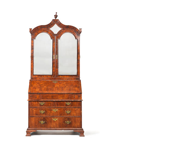 A Queen Anne walnut, crossbanded and featherbanded bureau cabinet