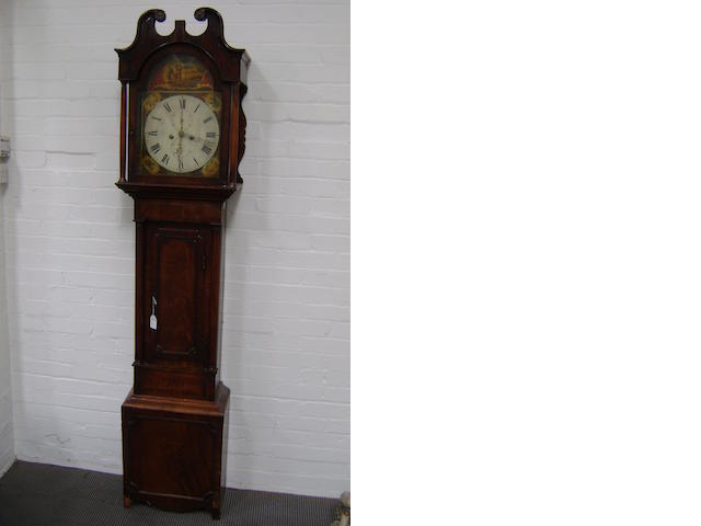 A regency mahogany 8-day longcase clock, the arched dial painted with a landscape and different flowers to the spandrels, the case with swan neck pediment and turned columns to the trunk, 213cm high