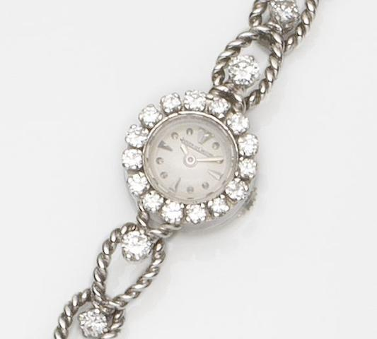 Jaeger-LeCoultre. A lady's 18ct white gold and diamond set manual wind bracelet watchCirca 1960