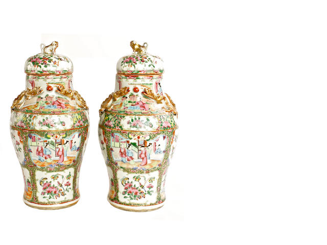 A pair of Canton export famille rose vases and covers, 19th century
