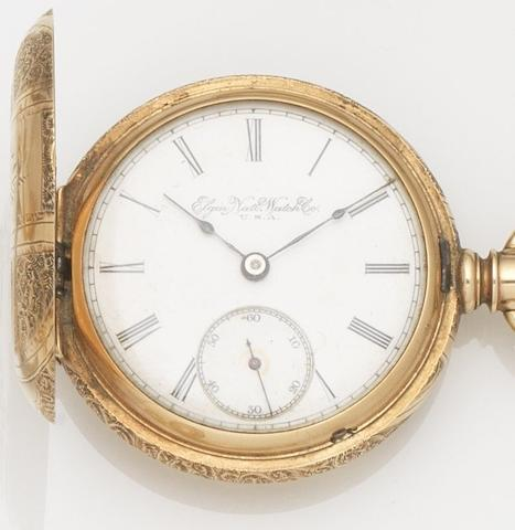 Elgin. A 14ct gold keyless wind full hunter pocket watch with chain and fob sealMovement No.6137465, Circa 1910