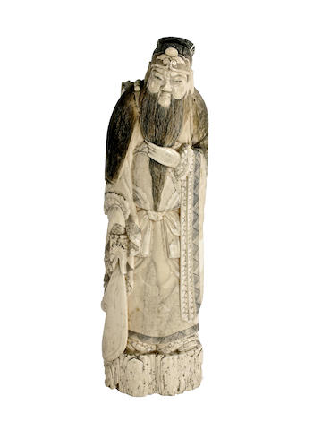 A Chinese carved ivory figure of a daoist immortal
