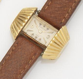 Cartier. A lady's 18ct gold manual wind back-winding 'sunburst' wristwatch Case No.662067, London Import mark for 1955