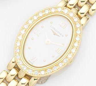 Longines. A lady's 18ct gold diamond set quartz bracelet watch Ref:L.6.110.7, Case No.29558542, Movement No.280.002, Circa 2000