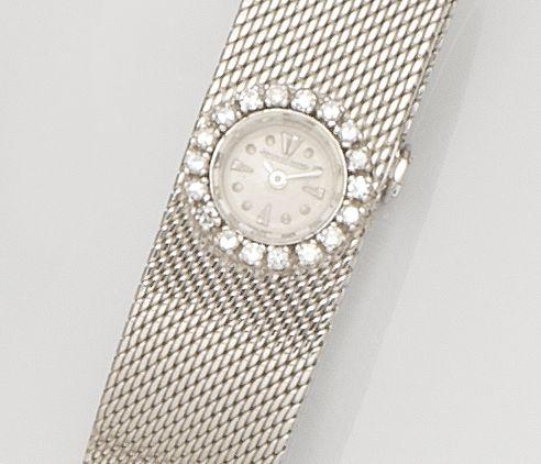 Jaeger-LeCoultre. A lady's 18ct white gold and diamond set manual wind bracelet watchCase No.969084A, Movement No.1886415, Circa 1960