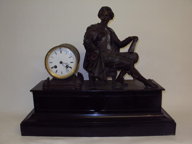A 19th century French black marble mantel clock with spelter artist figure