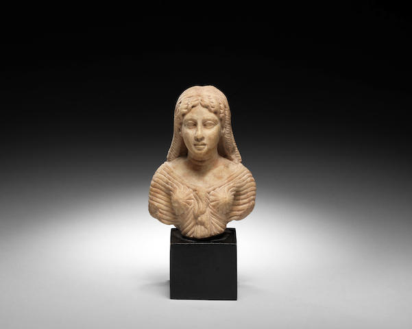 A Roman marble figure of an Isis priestess
