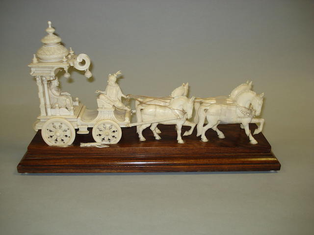 An Indian carved ivory group depicting a dignitary in a horse drawn carriage  Mid 19th Century