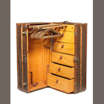 A large and impressive leather-cased wardrobe trunk,