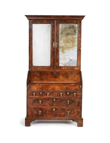 A George I walnut and featherbanded bureau cabinet A George I walnut and featherbanded bureau cabinet