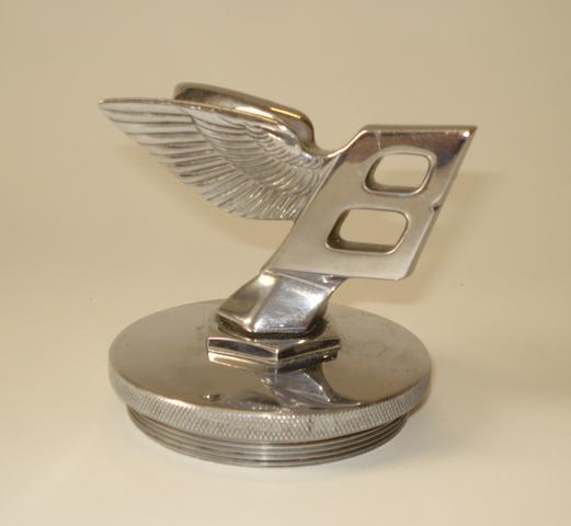 A pre-War Bentley forward leaning Winged 'B' mascot,