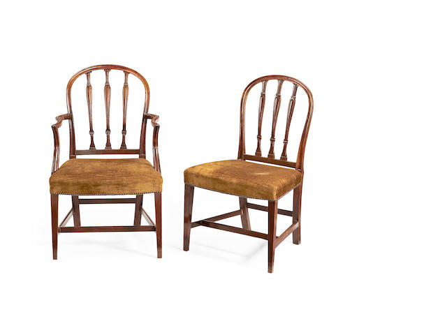 A set of fourteen Edwardian mahogany dining chairs in the George III style