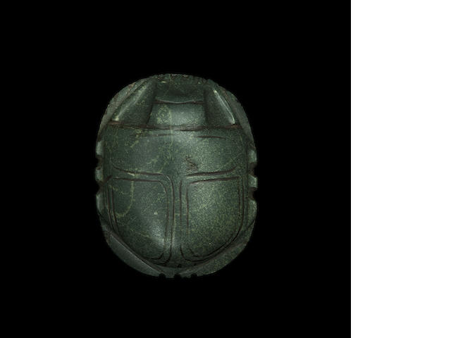 An Egyptian greenstone heart scarab