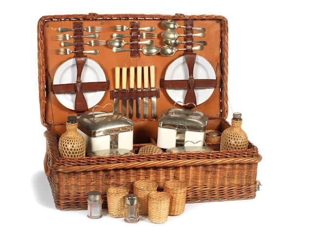 A 'Coracle' six person wicker cased picnic set, circa 1920,