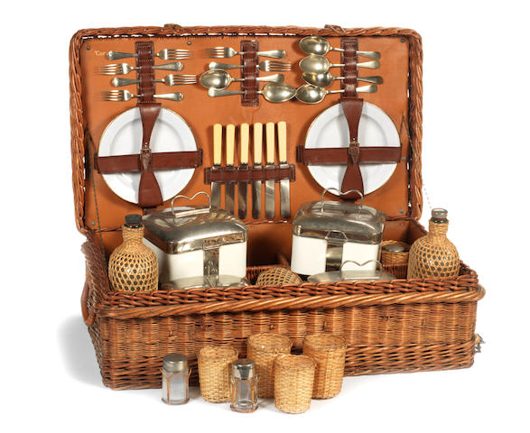 A 'Coracle' six person wicker cased picnic set, circa 1920,