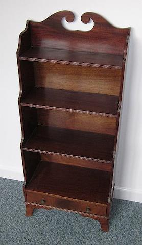 A Regency style mahogany waterfall bookcase
