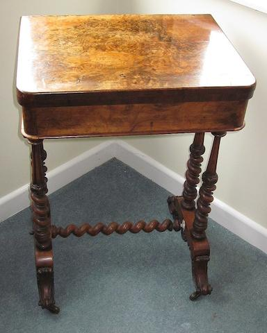 A mid Victorian walnut games table