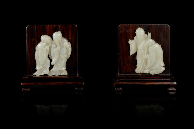 A pair of pale green jade 'sage' plaques mounted as table screens 18th/19th century