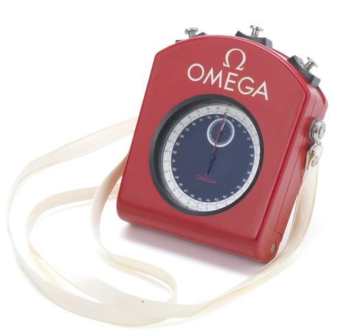 Omega. A rare and unusual plastic coated open face split 1/10th second stop watch together with fitted case and neck strapMovement No.2202662, 1960's