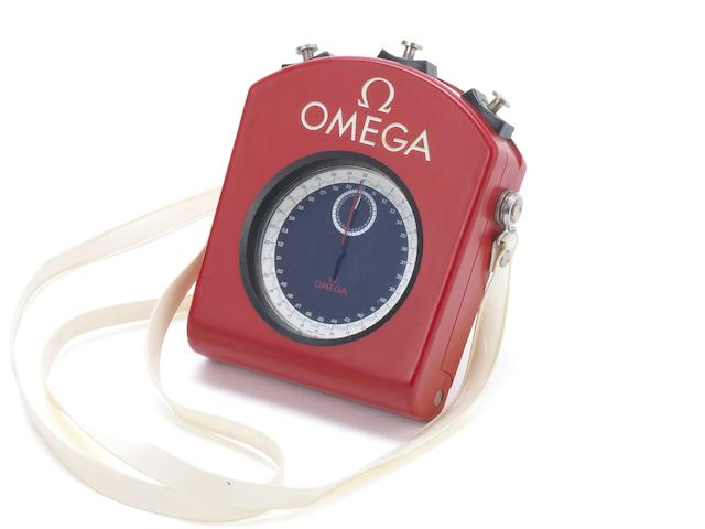Omega. A rare and unusual plastic coated open face split 1/10th second stop watch together with fitted case and neck strap Movement No.2202662, Circa 1960