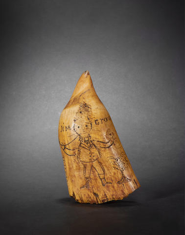 A scrimshawed whale's tooth,  American,  dated 1854,