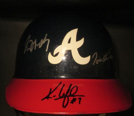 An Atlanta Braves hand signed baseball helmet